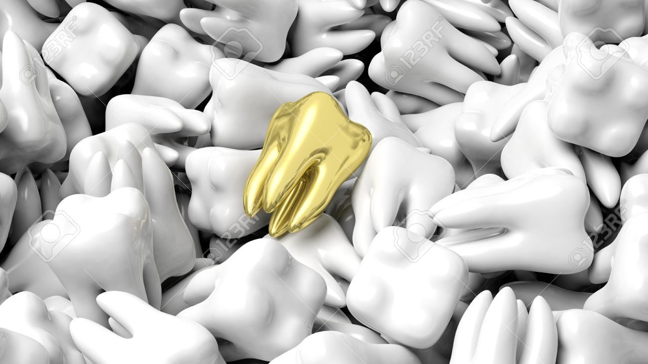 Pile of white teeth with one gold, abstract conceptual background