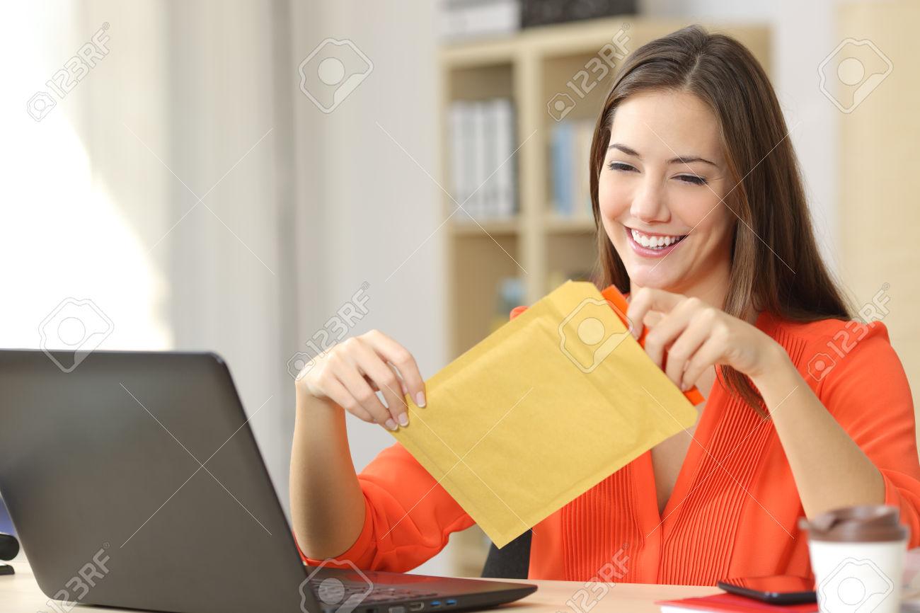 Freelancer opening a padded envelope
